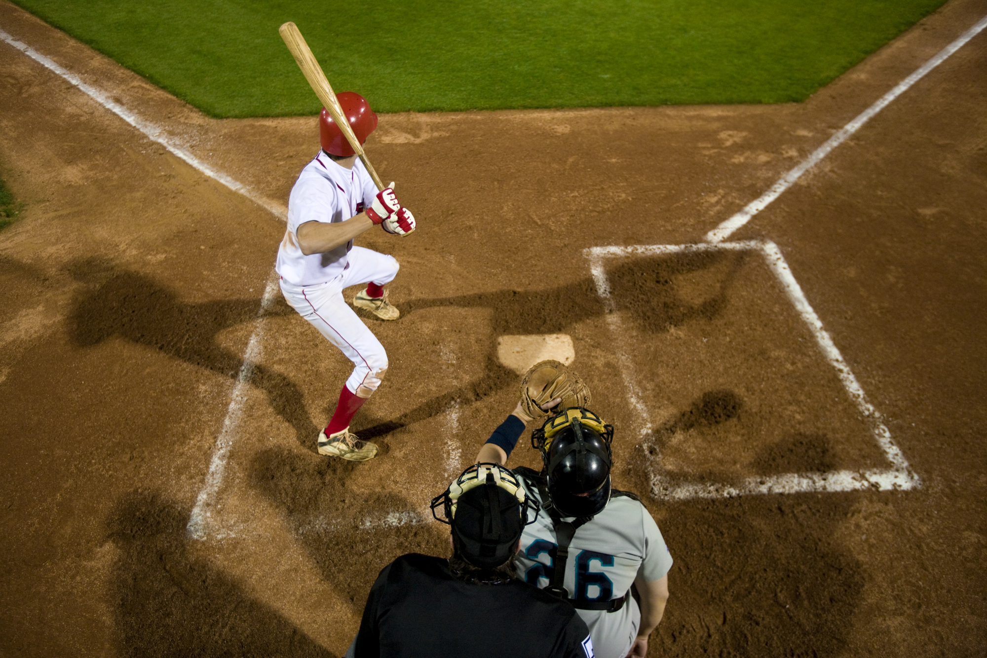 Two Baseball players in position for a pitch on a baseball field